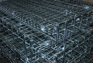 depositphotos_52389059-stock-photo-stack-of-sliver-cages